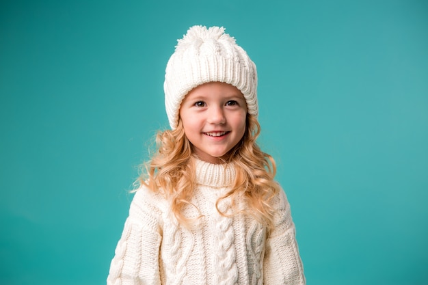 Little girl in winter knitted hat and sweater