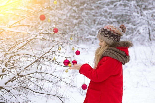 Little girl on a winter walk on a snowy day