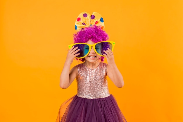 Little girl with big sunglasses and tutu