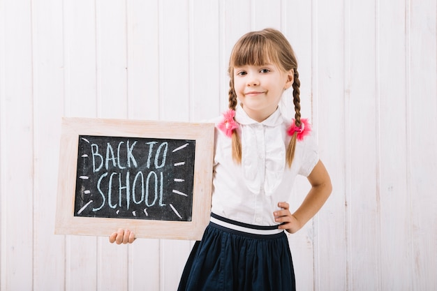 Little girl with blackboard