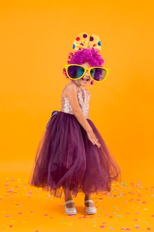 Little girl with clown wig and tutu