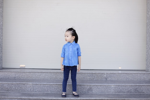 Little girl with denim clothes