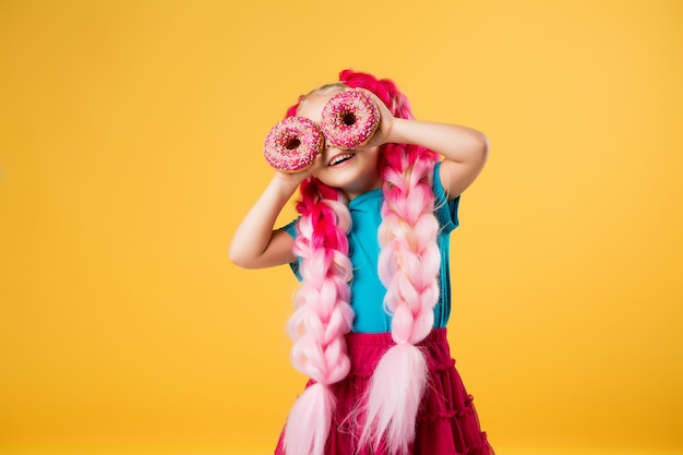 Little girl with donuts