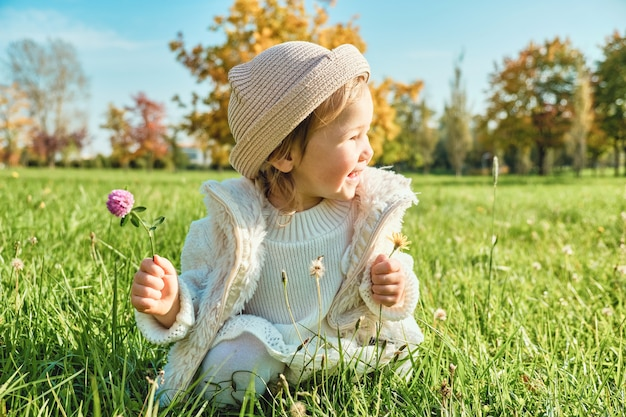 Little girl with flower in hand