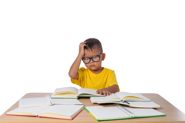 Little girl with glasses thought and many book on the table. back to school concept,
