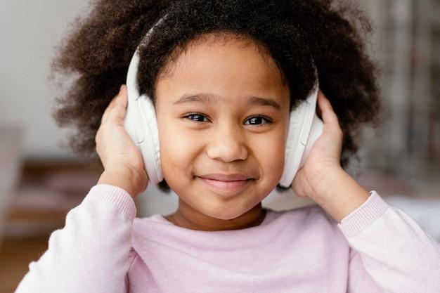 Little girl with headphones