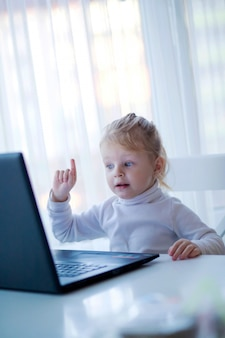 Little girl with laptop and phone