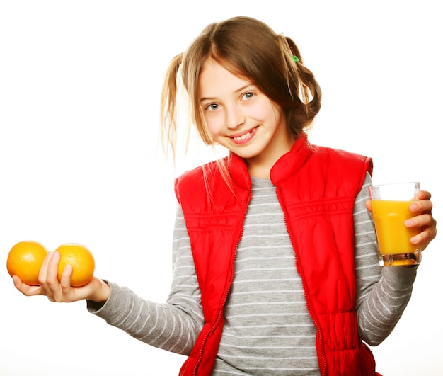 Little girl with oranges and juice