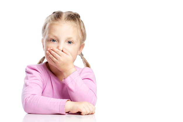 The little girl with pigtails covered her mouth with her hand.