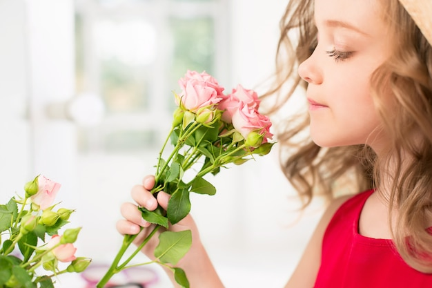 A little girl with roses