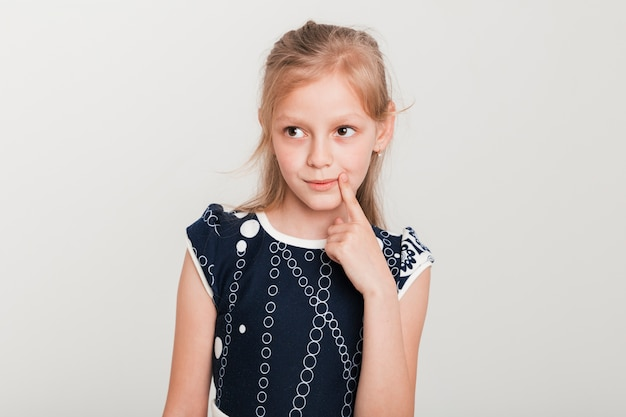 Little girl with thinking expression