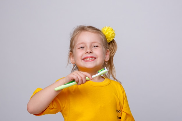 Little girl with a toothbrush, little girl with a toothbrush and an apple.