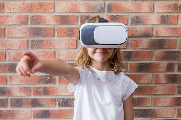 Little girl with virtual reality headset. innovation technology and education concept