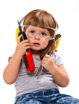 Little girl with work tools and screwdriver