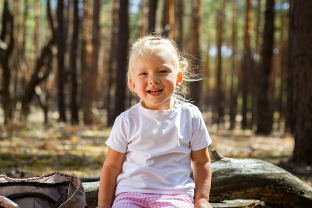 Little girl in the woods. walk with parents. walking with parents.