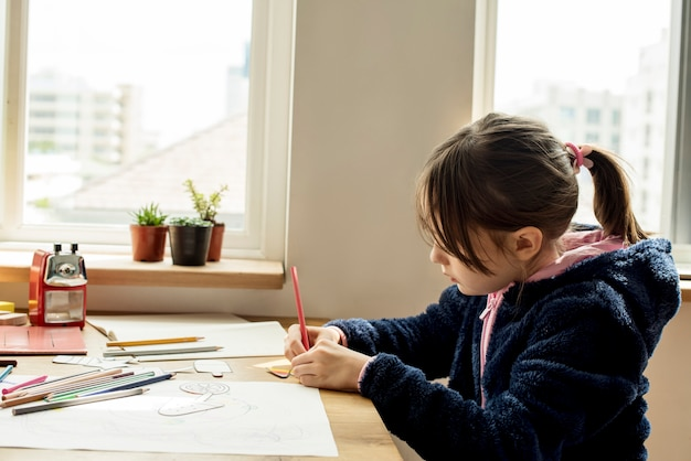 Little girl working on her assignment