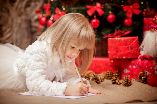 Little girl writes a letter to santa claus