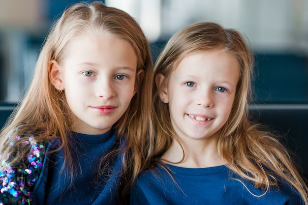 Little girls in airport while wait for boarding