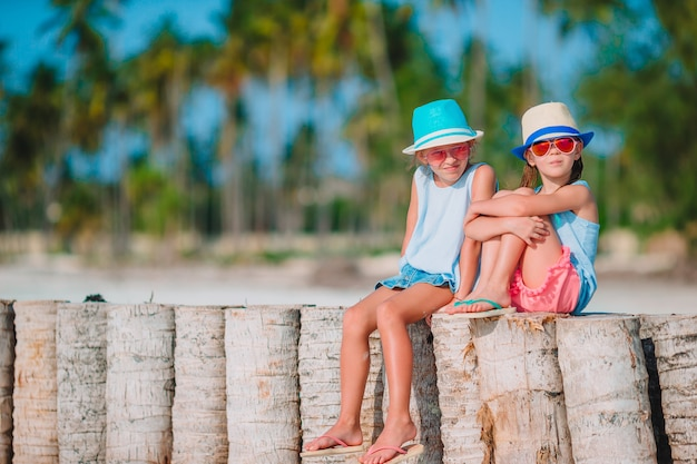 Little girls on the beach during summer vacation