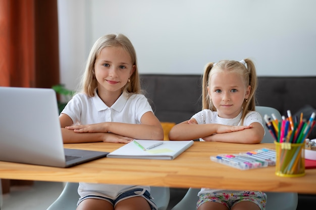 Little girls doing online school together