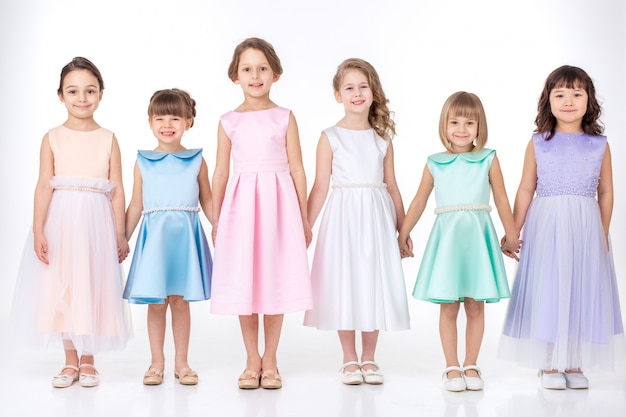 Little girls in dresses of princesses