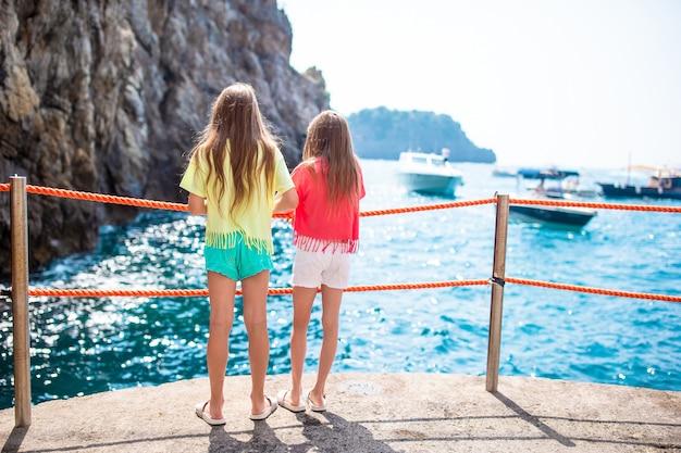 Little girls in emerald grotto, amalfi coast
