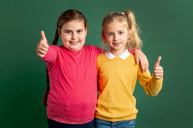Little girls showing ok sign