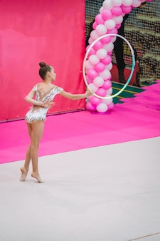 Little gymnast training on the carpet and ready for competitions