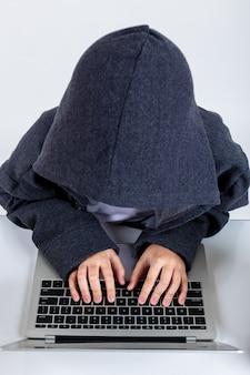 Little hacker boy with laptop