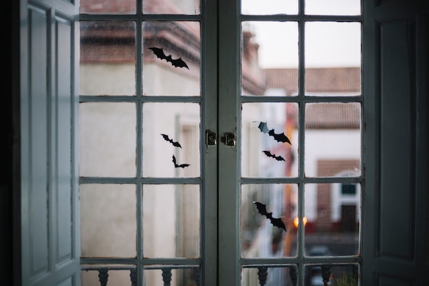 Little halloween paper bats on window