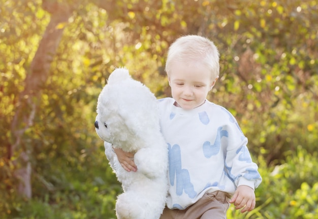 Little happy blond boy outdoor  on sunny summer day
