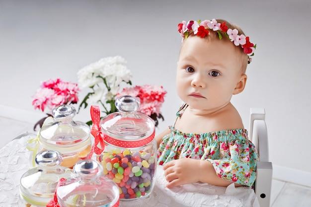 Little happy toddler girl celebrating first birthday.