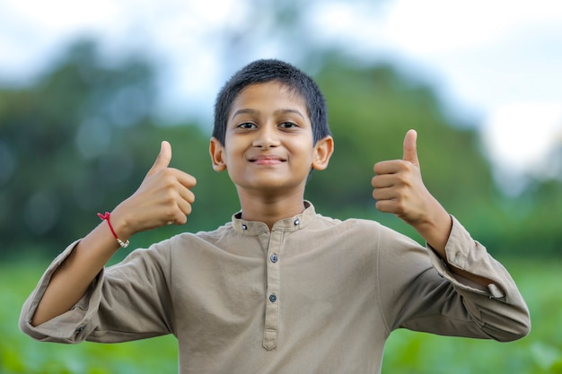 Little indian / asian boy showing thumbs up