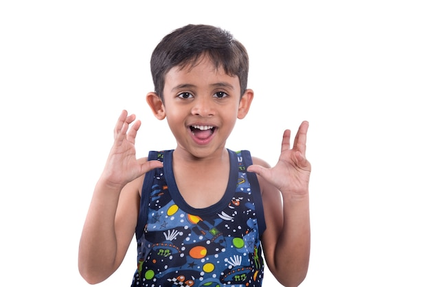 Little kid is giving surprised or shocking expressions on a white