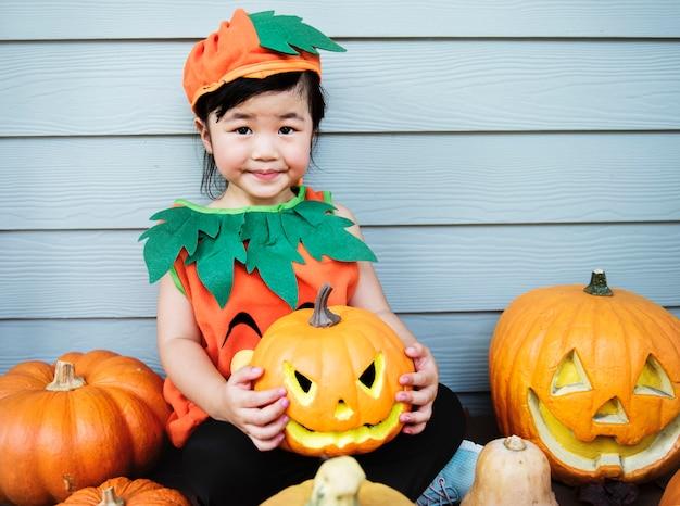 Little kid with halloween pumpkin