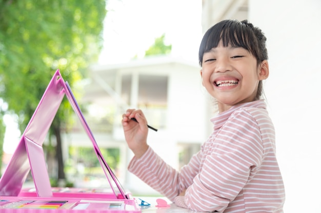 Little kids drawing with a colored pencil is a good activity for improving creative art and handwriting skills in children. concept picture for education and learning hobby.