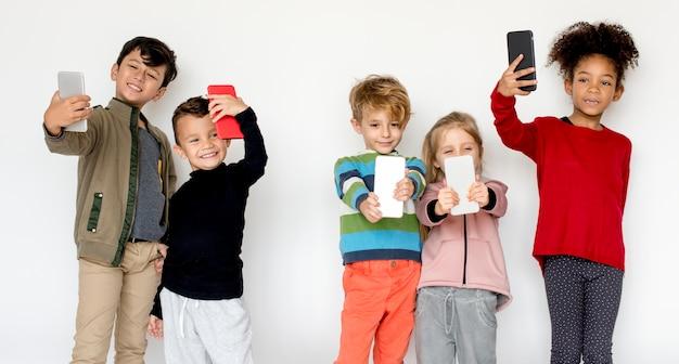 Little kids using smartphones