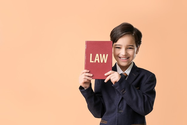 Little lawyer with book on orange