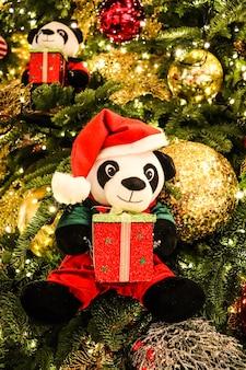 Little panda on christmas tree