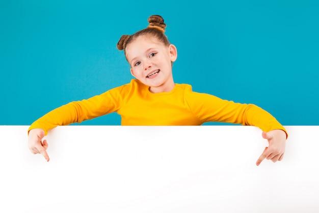 A little pretty girl wearing yellow shirt