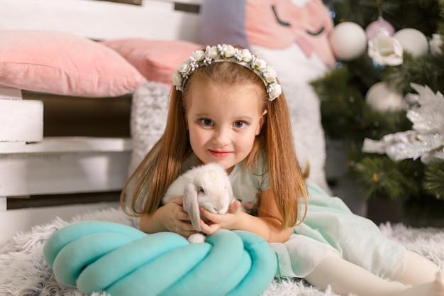 Little princess got rabbit for christmas. christmas magic fairy tale