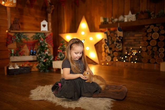 The little princess got a rabbit for christmas.