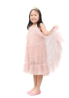 分離されたピンクのドレスでリトルプリンセス笑顔