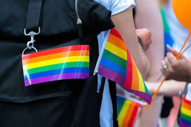 Little rainbow flag supporting lgbt community on gay parade event