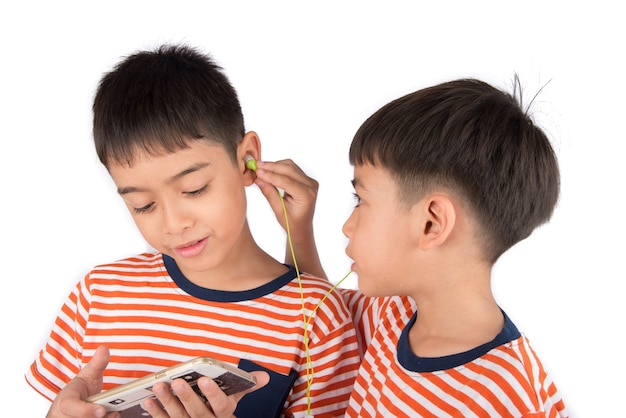 Little sibling boy playing game on mobile together