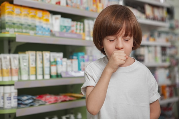 Little sick boy at the pharmacy