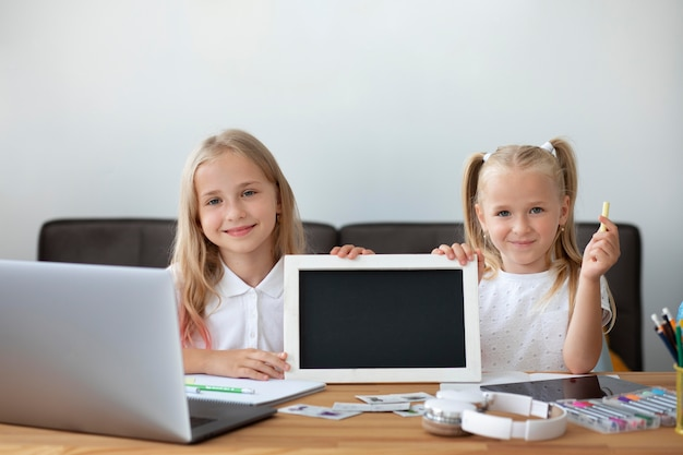 Little sisters doing online school together at home