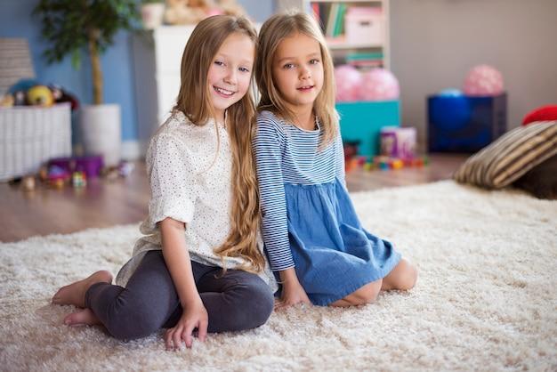 Little sisters in their bedroom