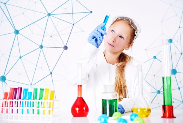 Little specialist in chemical laboratory