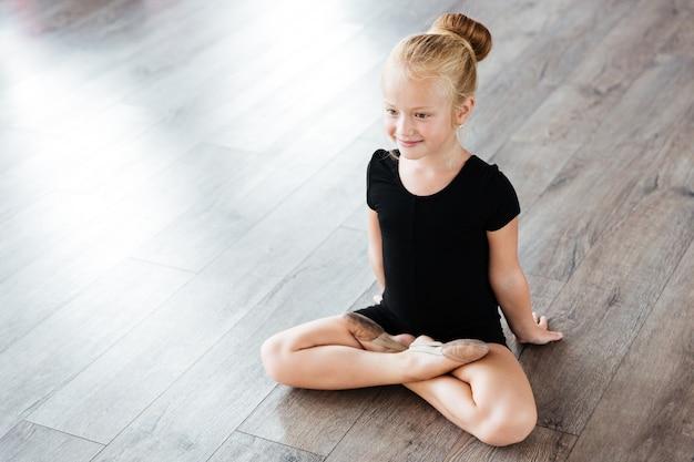 Little student in ballet school
